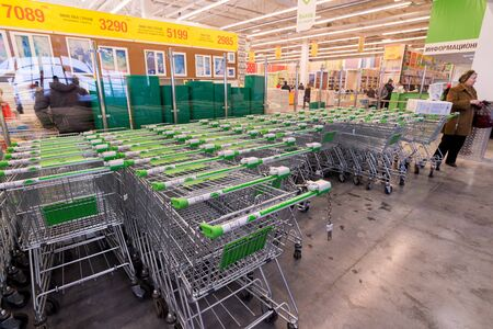 merlin: MOSCOW, RUSSIA-November 15: Lined up baggage trolleys at Leroy Merlin. Leroy Merlin is a French home-improvement and gardening retailer serving thirteen countries Editorial