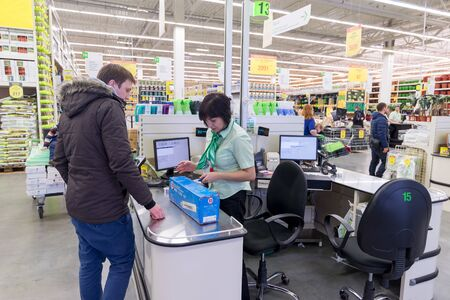 pay for: MOSCOW, RUSSIA - FEBRUARY 15: People pay for goods at the checkout in Leroy Merlin