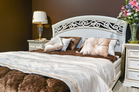 Elegant bedroom interior with a large bed