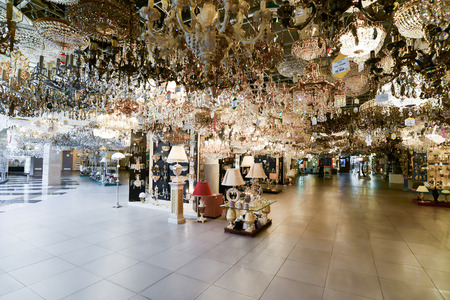 Many beautiful chandeliers in a light store