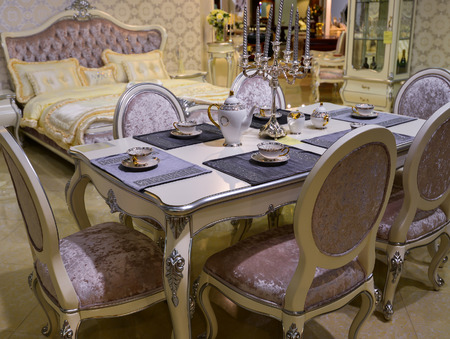 dining table and chairs: Dining table and chairs in the living room Stock Photo