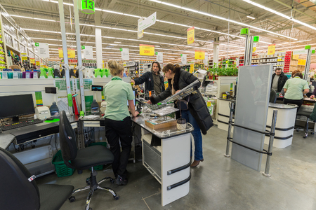 pay for: MOSCOW, RUSSIA - MARCH 14: People pay for goods at the checkout in Leroy Merlin Editorial