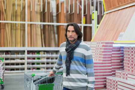 household goods: Portrait of  middle-aged man in a store household goods