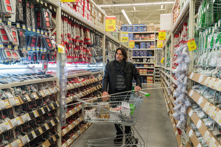 merlin: MOSCOW, RUSSIA - MARCH 03, 2015. A man makes a purchase of Leroy Merlin Store. Leroy Merlin is a French home-improvement and gardening retailer serving thirteen countries