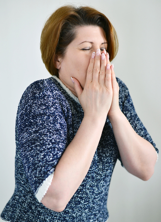 runny: An Adult woman with a runny nose