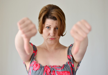 angry young woman showing her thumb down