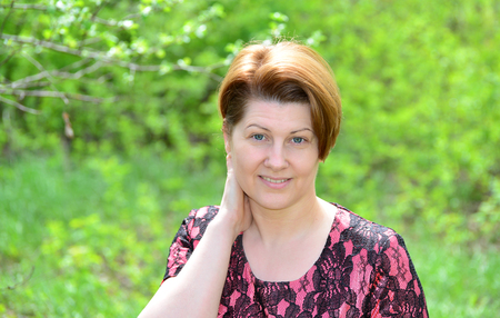 Portrait of a middle-aged woman on the nature Stock Photo
