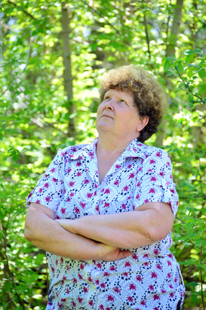 commercial tree care: Portrait of a mature woman in a nature