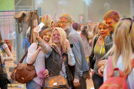 asian and indian ethnicities: MOSCOW, RUSSIA - MAY 23, 2015: Festival of colors Holi in  Luzhniki Stadium. Roots of this fest are in India, where it called Holi Fest. Now russian people celebrate it too.