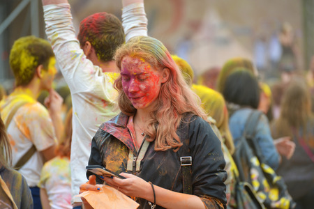 make dirty: MOSCOW, RUSSIA - MAY 23, 2015: Festival of colors Holi in  Luzhniki Stadium. Roots of this fest are in India, where it called Holi Fest. Now russian people celebrate it too.