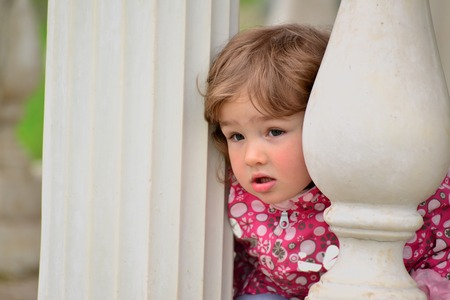 two year old: Two year old girl looks out from the gazebo