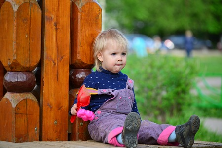 two year old: Two year old girl on a park bench