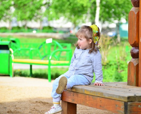 two year: Two year old girl on a park bench