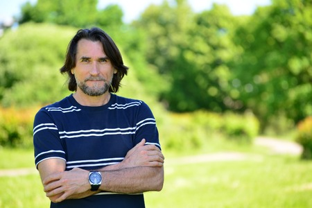 45 years old: Middle Age Man Standing Outdoors  in summer Stock Photo