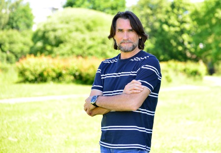 Middle Age Man Standing Outdoors  in summer 写真素材