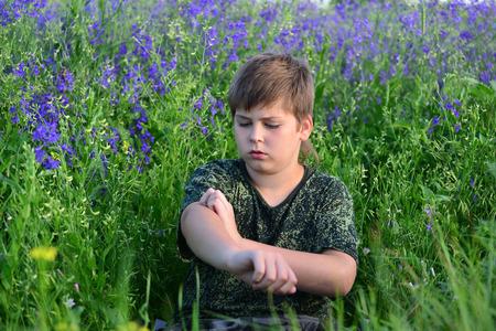 rheum: A teen boy with allergies in flowering herbs