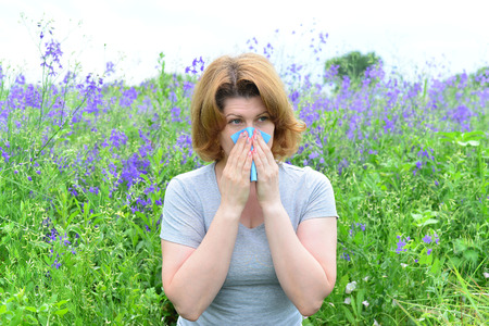 antihistamine: An adult woman with allergies on the Meadow