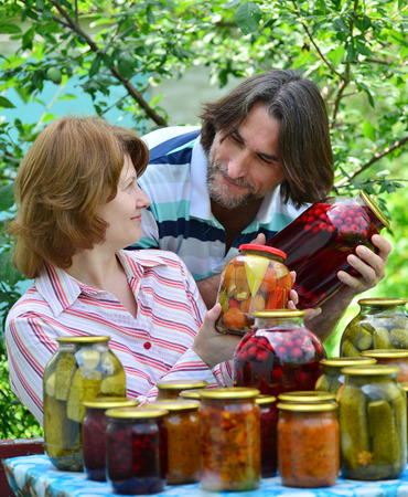 jams: A couple of middle age with homemade preserves and jams