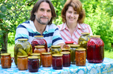 preserves: A couple of middle age with homemade preserves and jams