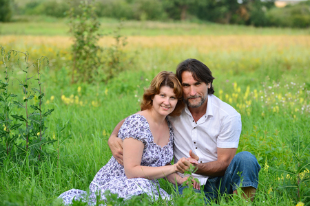 loving couples: A Loving couple relaxing on a meadow Stock Photo