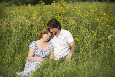 fortunate: A Loving couple relaxing on a meadow Stock Photo