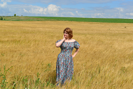 maxi: woman in maxi dress standing on the rye field