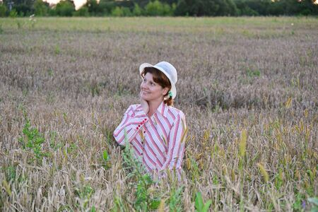 fortunate: A Pensive woman on a wheat field