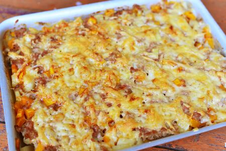 meat casserole with cheese on a baking sheet