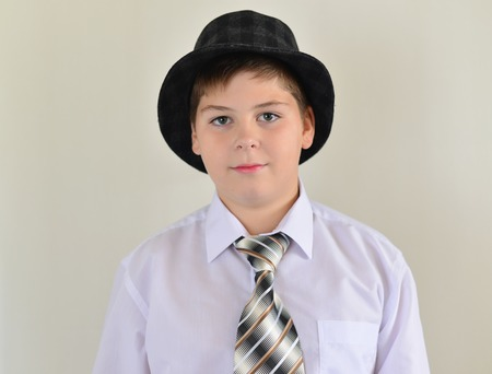 twit: portrait of a teenage boy in a hat and tie Stock Photo