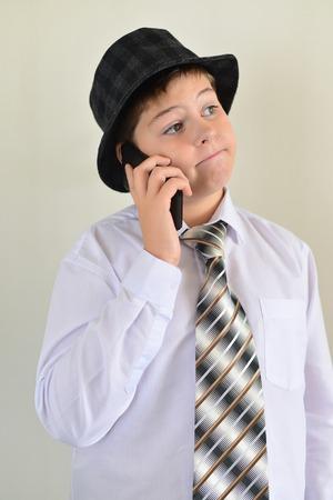 ravishing: Teen boy talking on cell phone on a light background