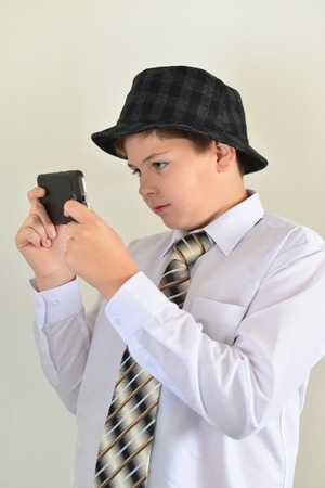 accosting: Teen boy with surprise looks at a mobile phone
