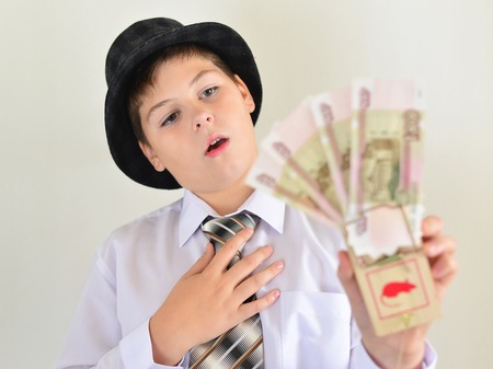 mousetrap: Boy teenager with a mousetrap in the hands of Stock Photo