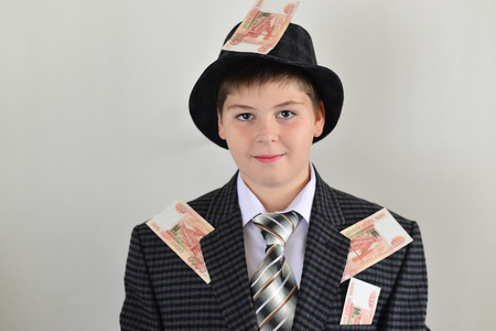 ludicrous: Boy teenager with a sticking to clothes Russian money Stock Photo