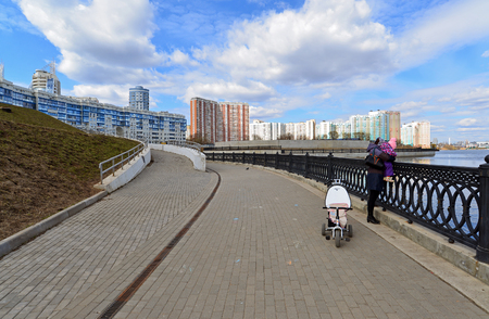 moskva river: Krasnogorsk RUSSIA - April 22.2015: The Zivopisnaya promenade on the banks of the Moskva River. Location walking people. Area residential development is about 2 million square feet