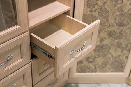 drawers: Fragment of a  beige cupboard with drawers