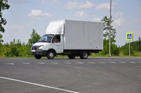 gazelle: LIPETSK, RUSSIA - 29.05. 2015. White truck Gazelle on the road