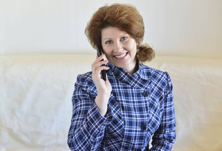 A Positive Woman talking on cell phone Imagens