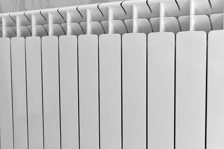 convection: A White heating radiator on the wall Stock Photo