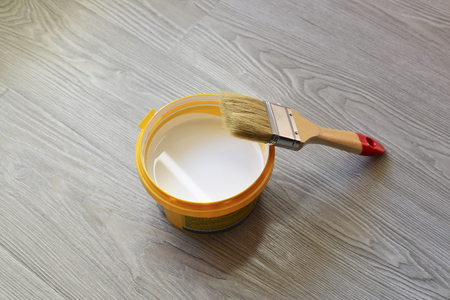 colouration: Bank with white paint and brush on the floor