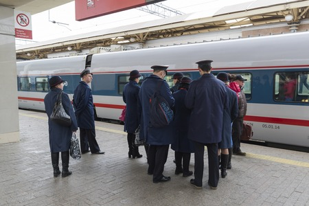 highspeed: MOSCOW, RUSSIA -01.11.2015. Conductor worth about High-speed train at a Kursky station