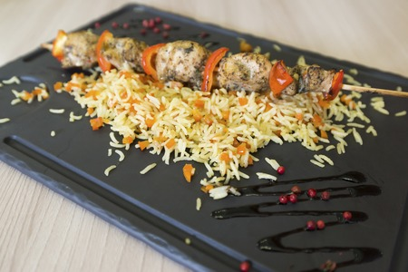 kabab: Chicken shish kebab and rice with a vegetables Stock Photo