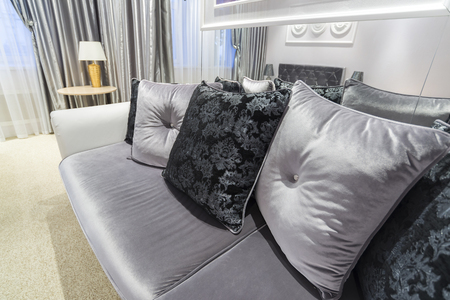 velours: Grey Pillow on sofa at a home