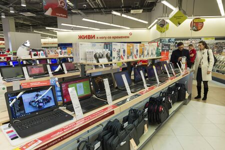 net trade: Khimki, Russia - December 22 2015. Laptops In Mvideo large chain stores selling electronics and a household appliances Editorial