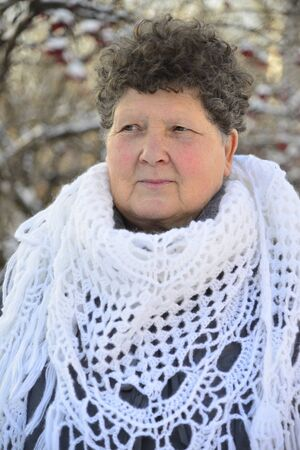european rowan: An elderly woman in a white knitted shawl costs about Rowan Stock Photo
