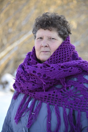 european rowan: A woman with a purple knitted shawl on his shoulders outdoors in winter