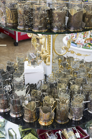 holders: Moscow, Russia - January 10 2015 Glass cups in metal cup holders in the gift shop