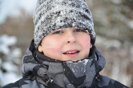 frostily: A Portrait of frozen boy in winter Stock Photo