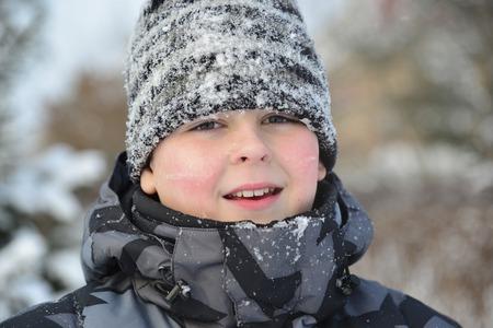 icily: A Portrait of frozen boy in winter Stock Photo