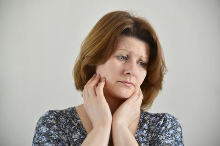 deplorable: Portrait of adult sad female on a light background Stock Photo