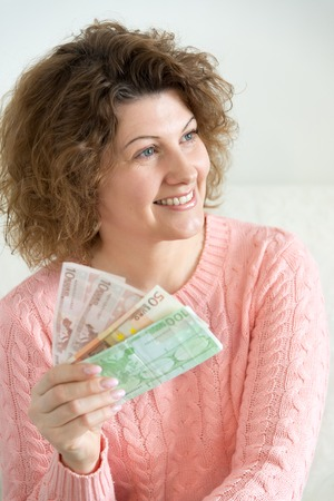 european money: An adult woman holding a European money
